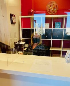 Marcy behind the plexiglass